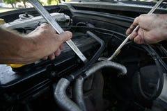Mechanic. A mechanic' hand fixing a car engine royalty free stock photo