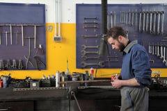 Mechanic. Auto mechanic in his workshop royalty free stock photos