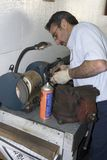 Mechanic 9. Auto mechanic works on a grinding wheel in his garage Stock Images