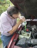 Mechanic Adding Engine Coolant To Customers Vehicle Royalty Free Stock Photo
