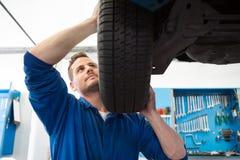 Mechanic adjusting the tire wheel Stock Image