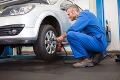 Mechanic adjusting the tire wheel Stock Photo