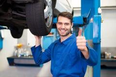 Mechanic adjusting the tire wheel Royalty Free Stock Image