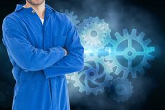 Mechanic against background with cogs Royalty Free Stock Images