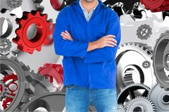 Mechanic against background with 3d cogs Stock Photo