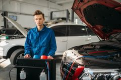 Mechanic at the air conditioning diagnostic system stock photo