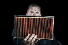 Mechanic and air filter Royalty Free Stock Photo