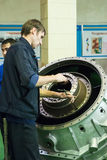 Mechanic assembles part for aviation engine Royalty Free Stock Photo