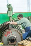 Mechanic assembles turbine for aviation engine Royalty Free Stock Photo