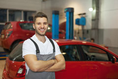 Mechanic in auto repair shop Stock Images