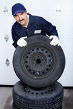 Mechanic with auto wheels Stock Photo