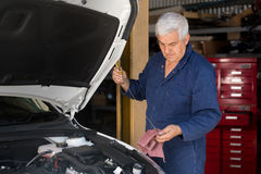 Mechanic in an automotive workshop Stock Image