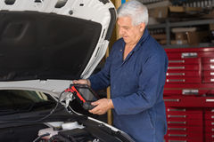 Mechanic in an automotive workshop Royalty Free Stock Image
