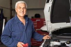 Mechanic in an automotive workshop Stock Photo