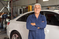 Mechanic in an automotive workshop Royalty Free Stock Images