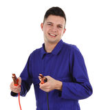 Mechanic with battery clamps Royalty Free Stock Photos