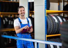 Mechanic in blue uniform holding a clipboard Royalty Free Stock Photo