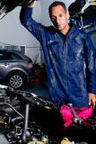 Mechanic with a car Royalty Free Stock Photo
