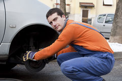 Mechanic and car brakes Stock Photos