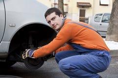 Mechanic and car brakes Stock Photos