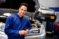 Mechanic at a car garage Royalty Free Stock Image