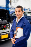 Mechanic at car garage Stock Photo