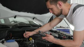 Mechanic car service inspects electrical system machine. And its technical condition, maintenance, computer diagnostics automobile setup stock video