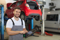Mechanic at the car service Royalty Free Stock Images