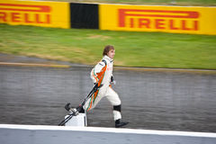 Mechanic carrying F1 nose at Montreal Grand prix Stock Photos