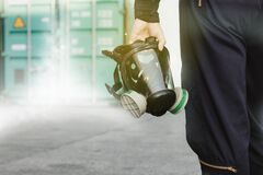 Mechanic carrying serious chemical protection mask