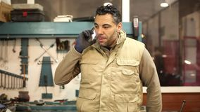 Car mechanic in his workshop stock footage