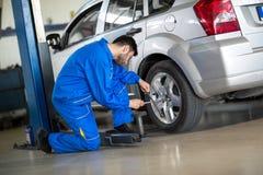 Mechanic change tyre Stock Image