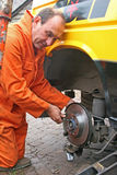 Mechanic changing brake disc. On van Royalty Free Stock Photo