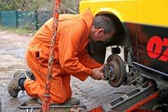 Mechanic changing brake disc Royalty Free Stock Photos