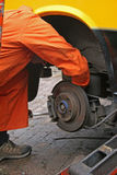 Mechanic changing brake disc. On van Royalty Free Stock Image