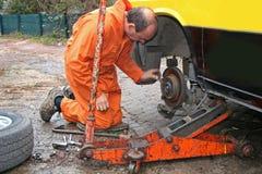 Mechanic changing brake disc Royalty Free Stock Photo