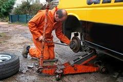 Mechanic changing brake disc Stock Images