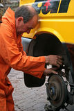 Mechanic changing brake disc. On van Royalty Free Stock Photography
