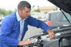Mechanic changing car battery. Man royalty free stock image