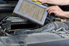 Mechanic changing car filter Royalty Free Stock Photos