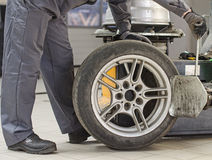 Mechanic changing car tire. Stock Images
