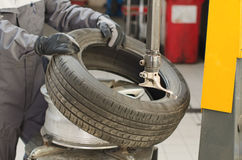 Mechanic changing car tire. Royalty Free Stock Photography
