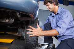 Mechanic Changing Car Tire Stock Photography