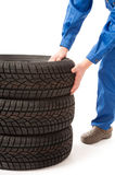 Mechanic is changing car tires on white background Royalty Free Stock Image