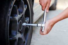 Mechanic changing car wheel Royalty Free Stock Photography