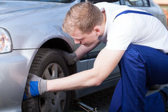 Mechanic changing car wheel Stock Photography