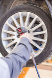 Mechanic changing car wheel. Stock Photos