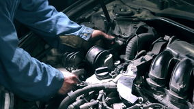 Mechanic changing engine component stock footage
