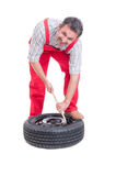 Mechanic changing tire Royalty Free Stock Images