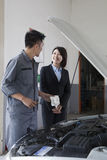 Mechanic Chatting and Laughing with Customer Stock Images